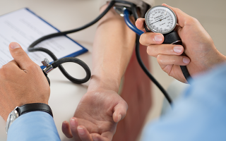 stock-photo-close-up-of-a-doctor-checking-blood-pressure-of-a-patient-159748715