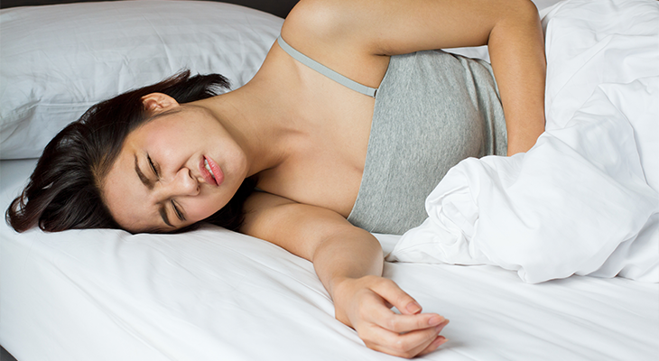 stock-photo-menstruation-pain-or-stomach-ache-on-bed-159452561