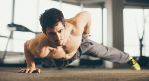 stock-photo-portrait-of-a-handsome-man-doing-push-ups-exercise-with-one-hand-in-fitness-gym-373416934
