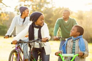46685271 - young smiling family doing a bike ride on an autumns day