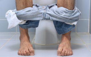 79055752 - man sitting on toilet