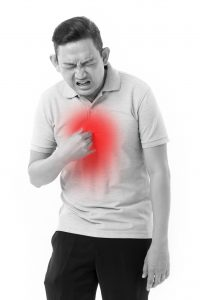 man suffering from acid reflux