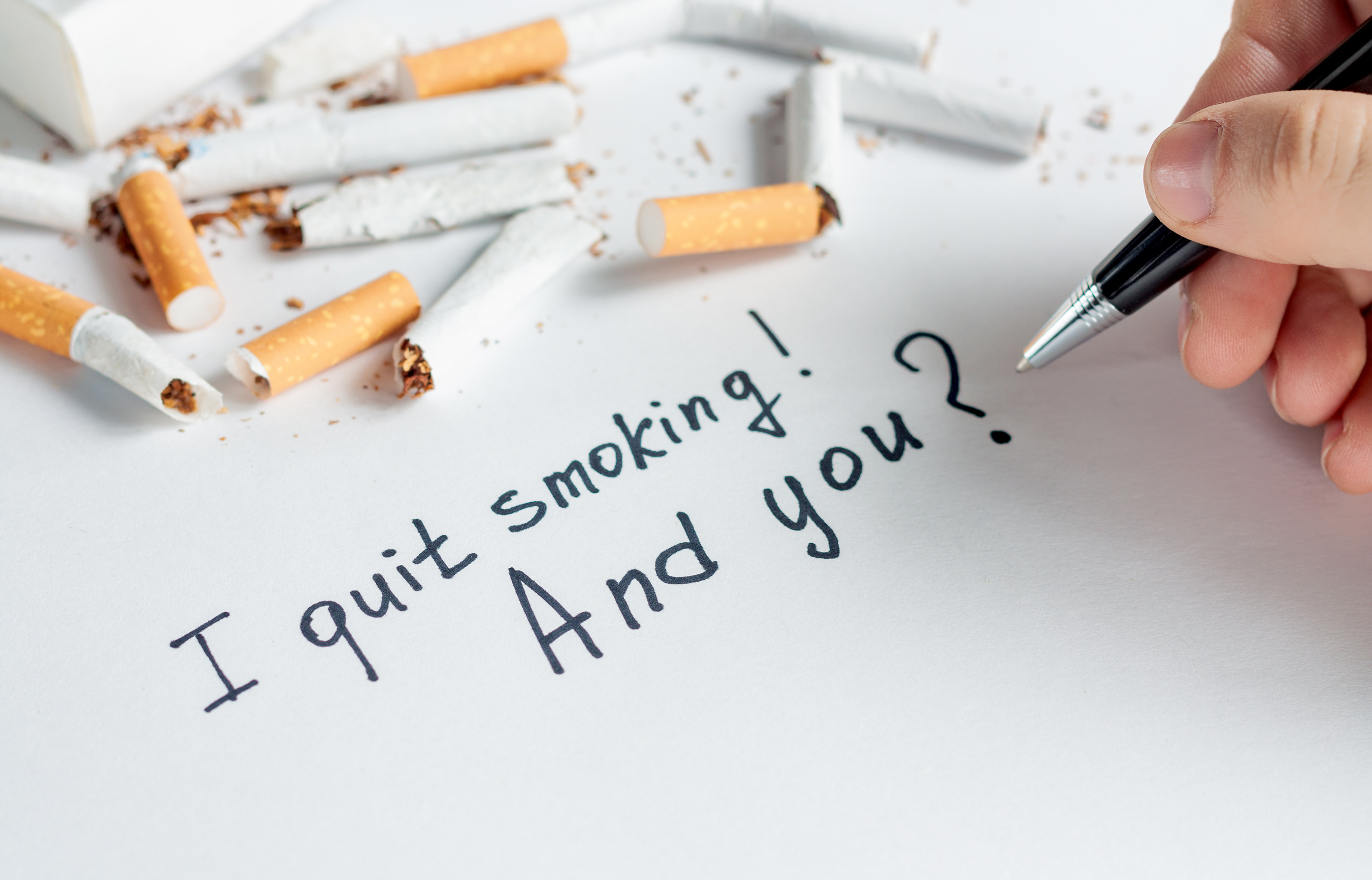 Antismoking background with a heap of broken cigarettes. Quit smoking now